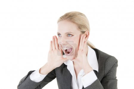 Close-up of a businesswoman screaming...