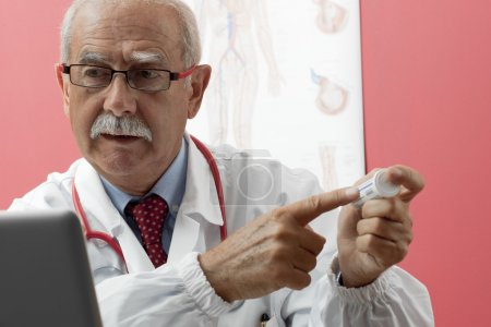 Senior Doctor Using Webcam
