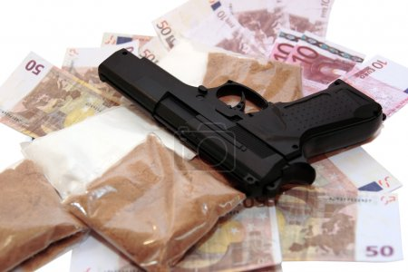 A stash of drugs gun and money showing a dangerous...