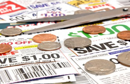 Photo for Saving money while cutting coupons - Royalty Free Image