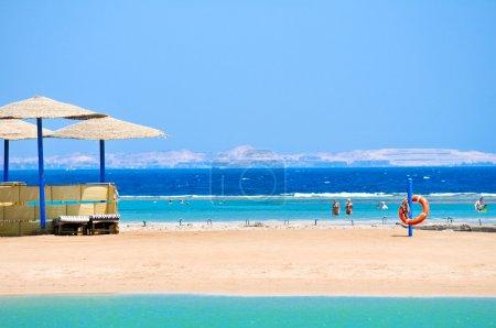 Straw umbrellas on the beach of Egypt