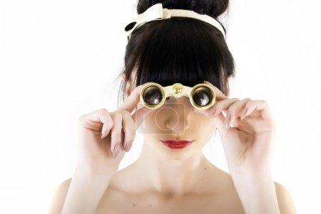 Beautiful woman looking through binoculars