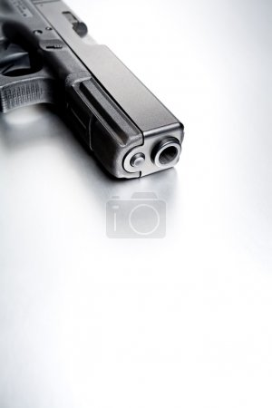 Gun on brushed metal background