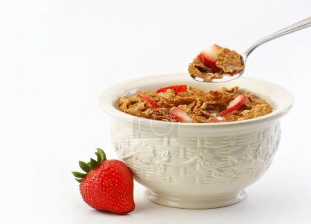 Photo for Bowl of cereal, milk, spoon and strawberries on white background - Royalty Free Image