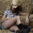Young brunette cowgirl sleeping with her hat down ...